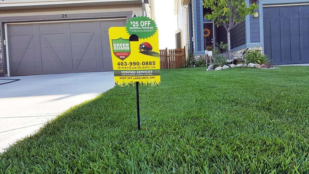 lawn sign from green guard lawn fertilization and weed control