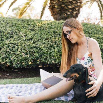 woman and dog enjoy weed free lawn
