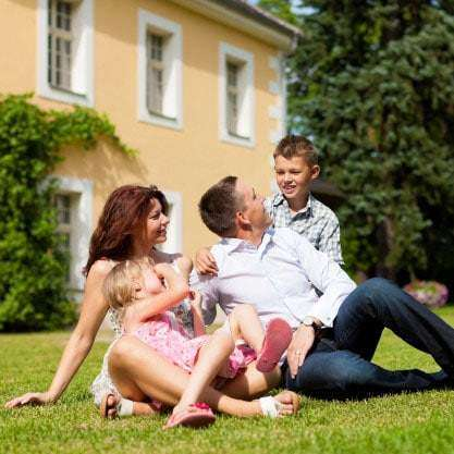 family enjoys green fertilized grass with weed control treatment