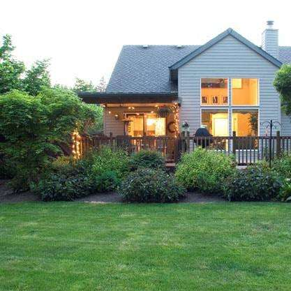 calgary house with weed control and lawn fertilizer treatment