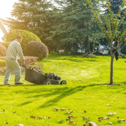 calgary man mowing the lawn for lawncare maintenance
